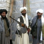 Former Taliban soldiers display their weapons during a ceremony in the western city of Herat