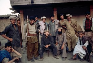 00514_10 Photographer, Steve McCurry, poses with a group of Afghani men, 1979.